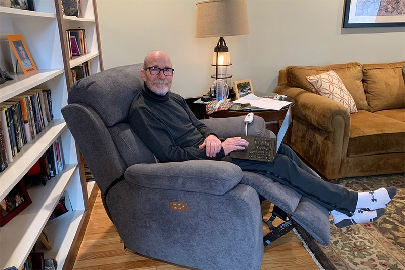 man sitting in recliner in home