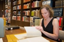 Carol Faulkner, chair of the Department of History, examines historic documents in Bird Library Archives