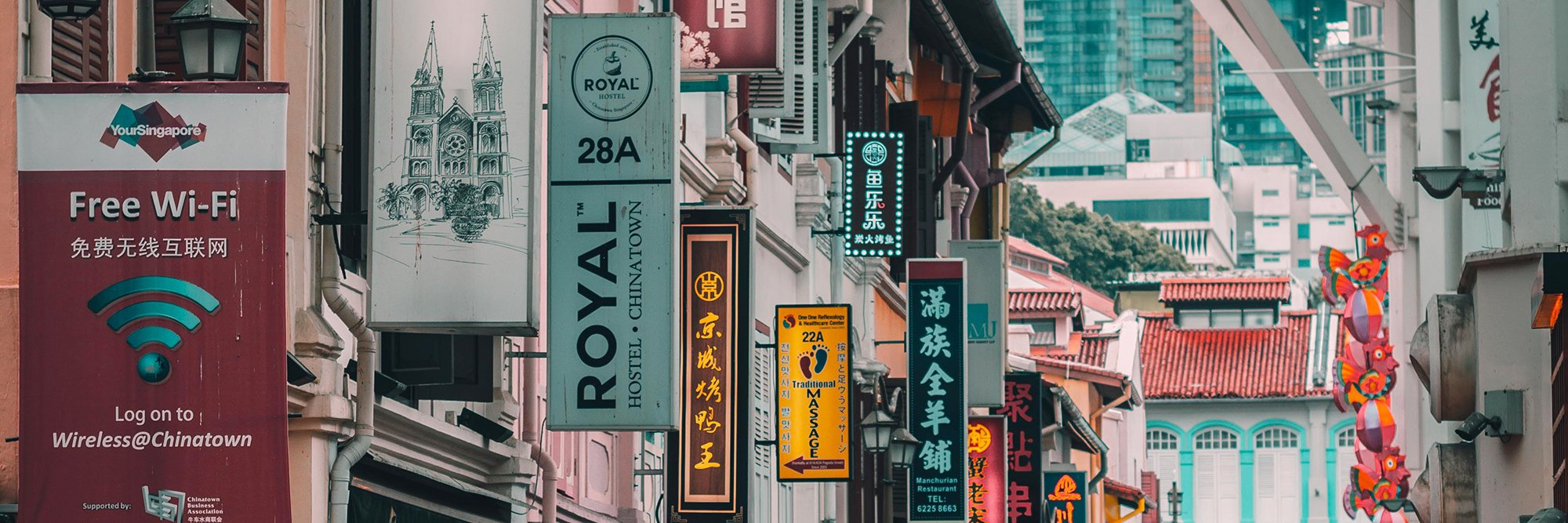 Chinatown, Singapore featuring hanging advertising banners in chinese and english