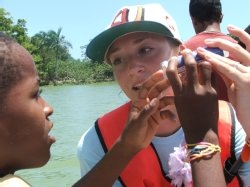 Alaina Mallette shows student how to use the water test kits on the Yasica River in the Dominican Republic
