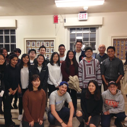 Group of  20 asian students with a faculty member