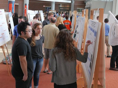 Students present their research in the Milton Atrium of the Life Sciences Complex during the 2016 REU poster session.