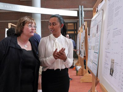 Dean Karin Ruhlandt listens as a 2016 REU student, Kim La, discusses her research project