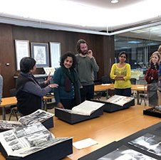 Four people looking at Special Collections items