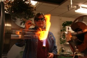 Sally Prasch creates a glass aparatus that will be used in a chemistry laboratory.