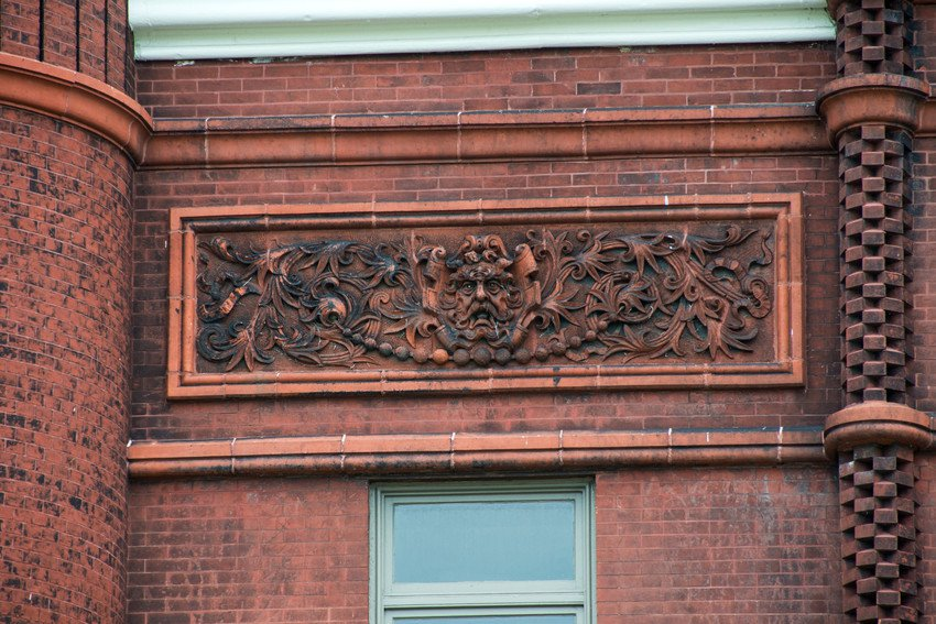 Detailed ornamental work on the exterior of Tolley Hall.