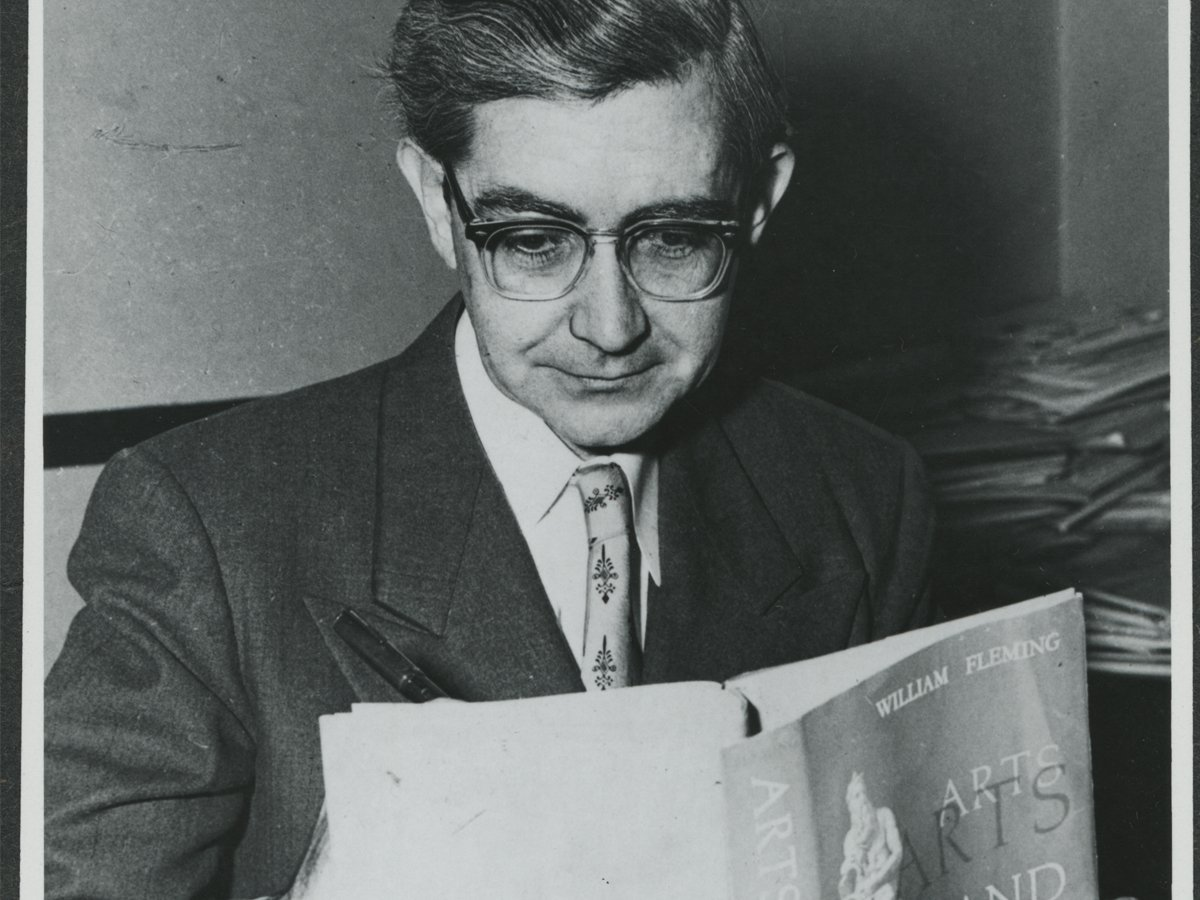 William Flemming reading a book.