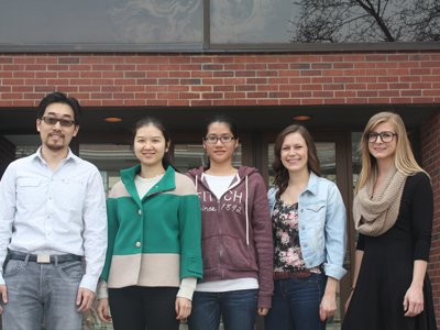 Professor Zunli Lu shown with members of his research lab at Syracuse University.