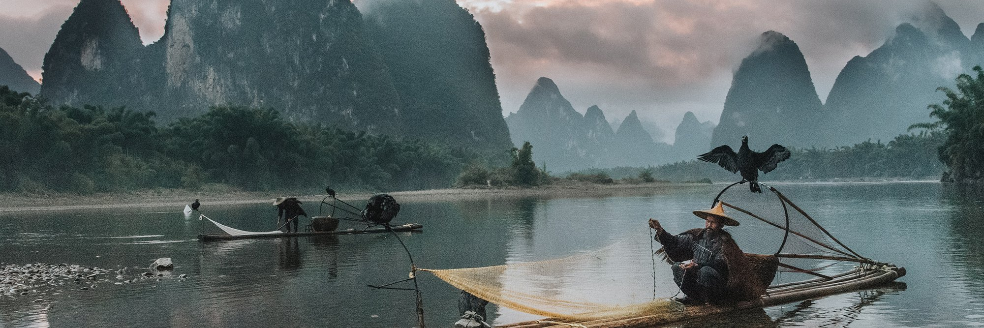 Sunset on the Li River as the few remaining cormorant fisherman pack