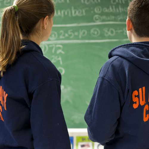 Students in SU Literacy Corps sweaters