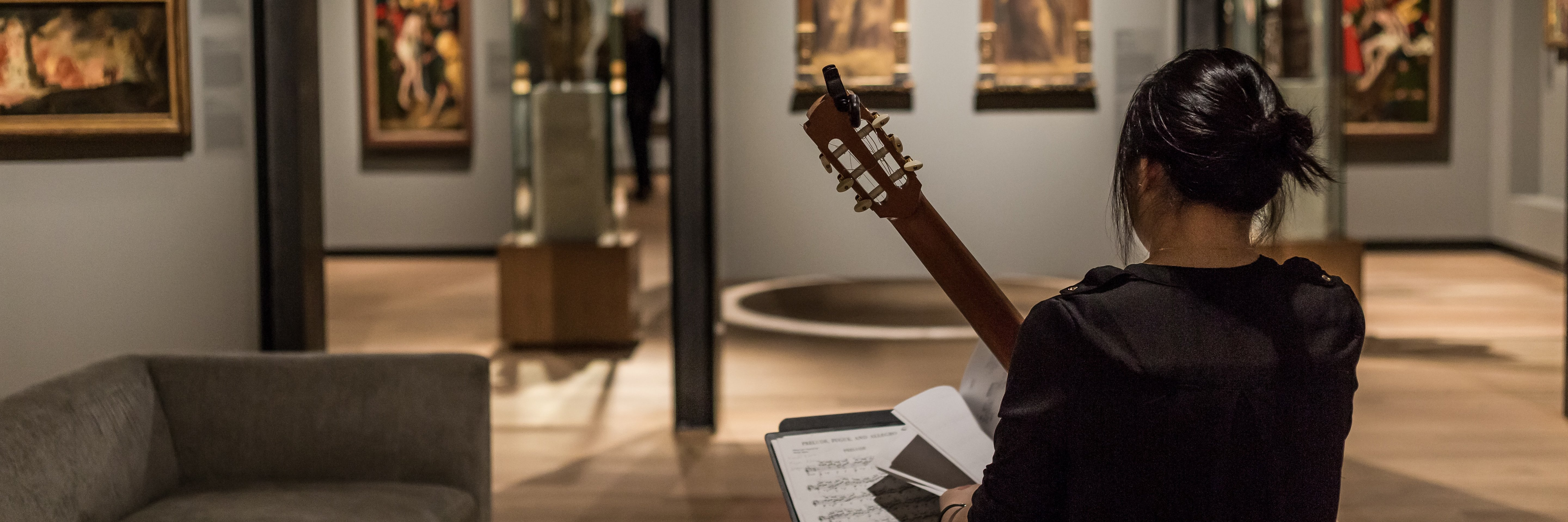 Guitarist in an art museum in Montreal, Canada