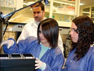 Michael Marciano with Danielle Lindgren '14 (left) and Victoria Czabafy '15 in one of Syracuse's new bioforensics labs