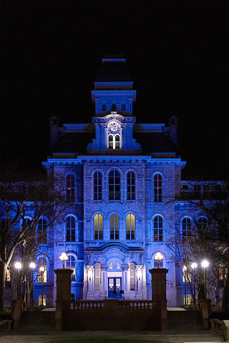 Hall of Languages lit up blue