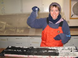 Zunli Lu's research associate, Professor Rosalind Rickaby of Oxford University, digs out ikaite crystals from a sediment core obtained off the coast of Antarctica. The sediment cores and the crystals must be stored in a freezer or the crystals will melt.