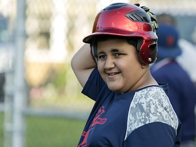 Khalik Pinet, a member of  the West End Little League, awaits his turn at bat at Lewis Park. (Photo by Marilu Lopez Fretts)