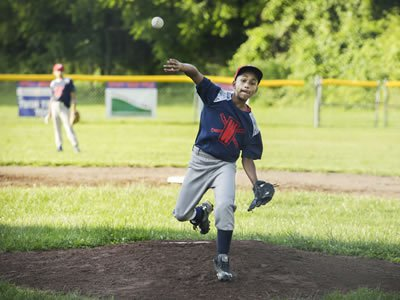 Jondale Dávila, 12, is a star pitcher for Syracuse Parks and Recreation's District 8 Little League Baseball. (Photo by Marilu Lopez Fretts)