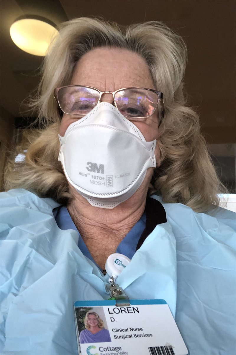 woman wearing scrubs and a mask