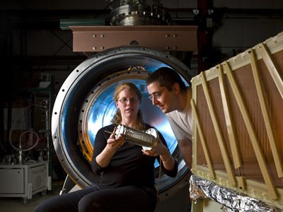 Mitchell Soderberg and Yale physicist Bonnie Fleming inspect a prototype of the MicroBooNE detector at Fermilab (Courtesy of Fermilab)