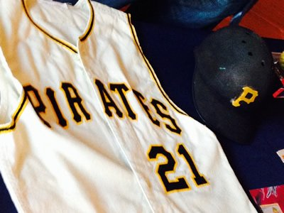 Roberto Clemente's helmet and jersey, at the National Museum of American History. The Puerto Rican-born right fielder played 18 seasons with the Pittsburgh Pirates, before his untimely death in 1972.