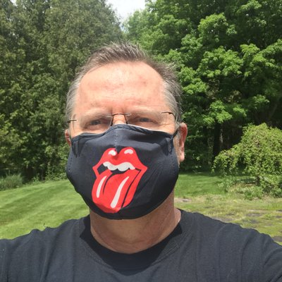 David Sobel wearing a Rolling Stones face mask.