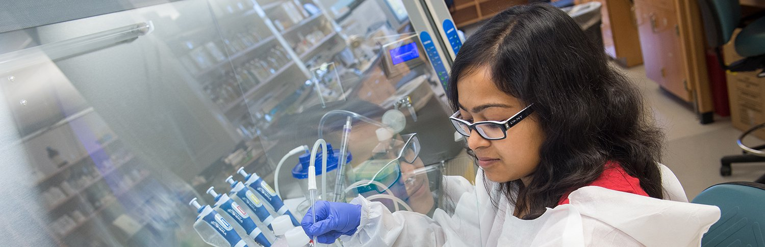 female chemistry student working in the lab