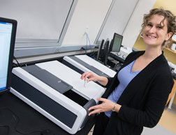 Chemistry professor Tara Kahan with one of the department's new spectrometers