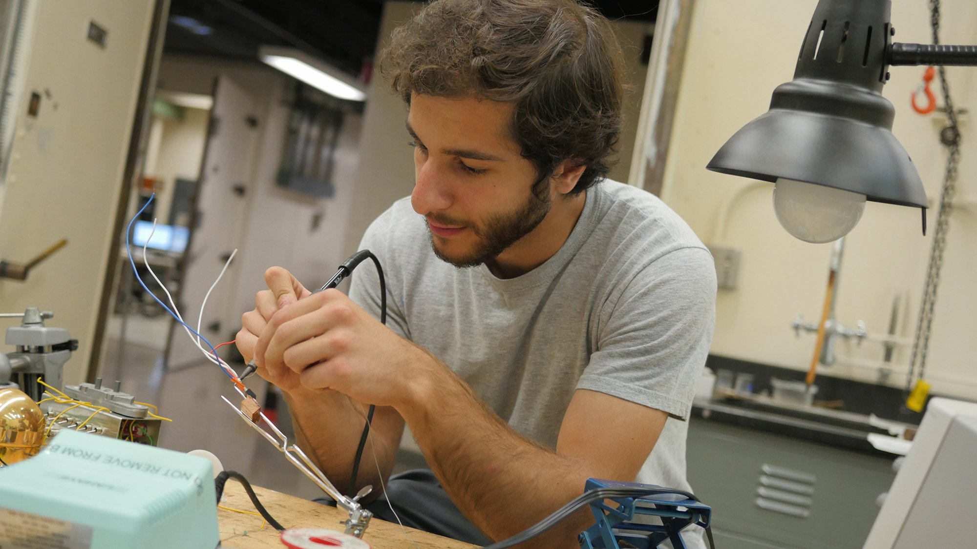 student soldering wires