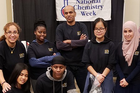 Miriam M. Gillett-Kunnath G'08 (back row, far left) and her husband, Bobby Kunnath (back row, center), with students.